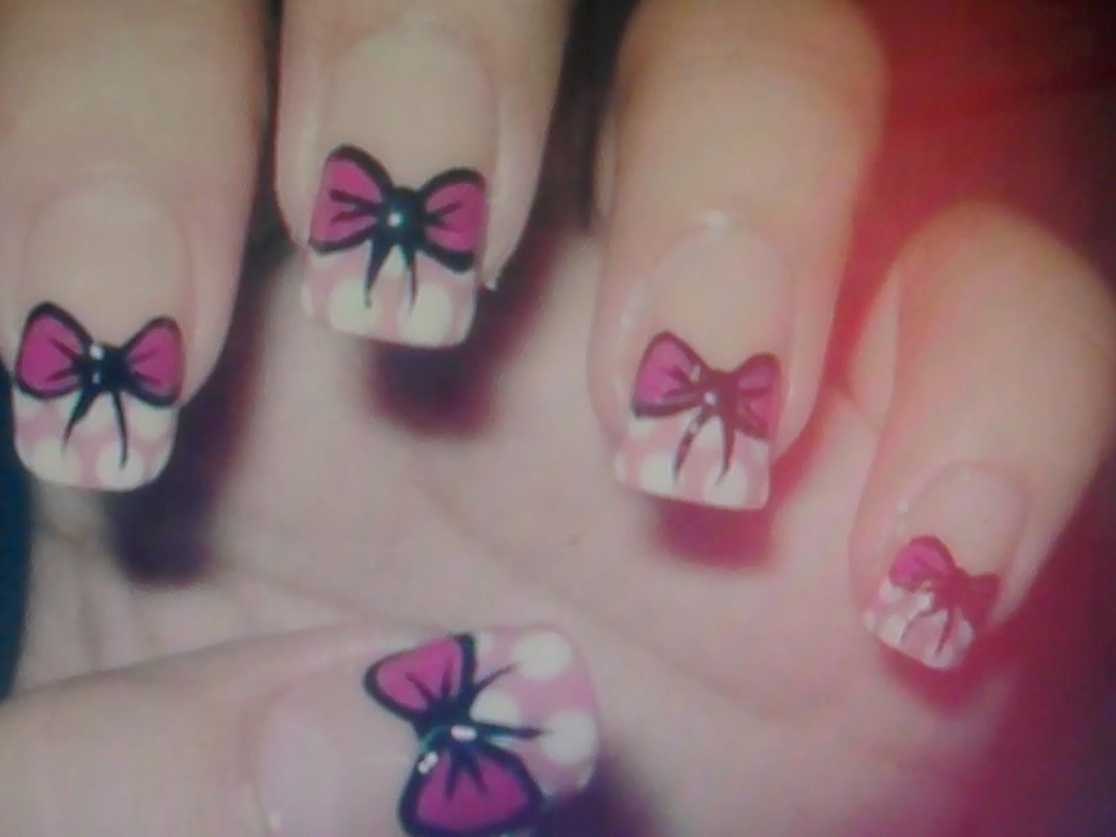 Gostou dos modelos de unhas decoradas com lacinhos? É um modelo mais