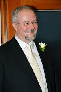 Greg smiling, looking at her bride, Michlle, at the Salisih Lodge and Spa