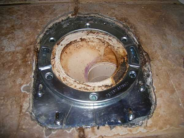 how to change a broken toilet flange