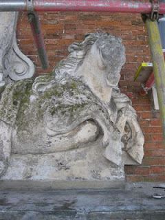 horse carving on North door at Beningbrough Hall before restoration