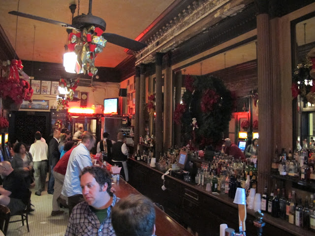 Tujaque's vintage 1856 stand-up bar and ornate mirror.