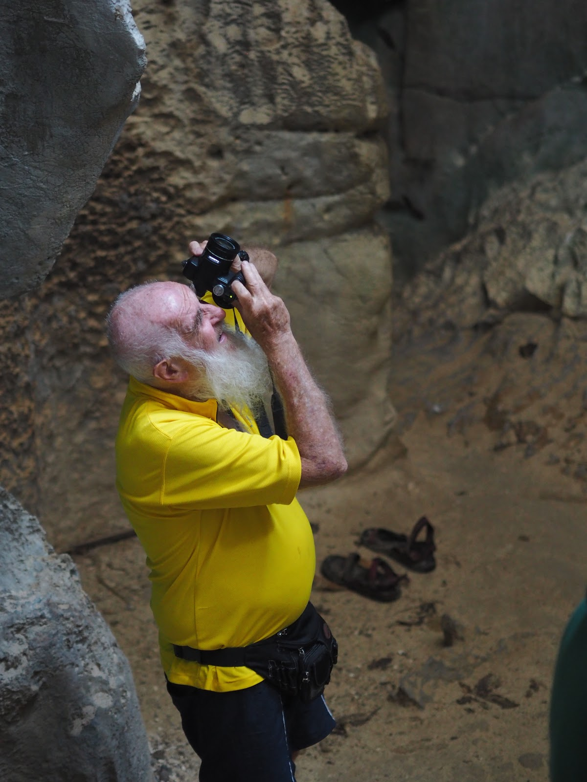 man with camera in cave, philippines