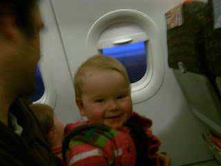 baby smiling on plane