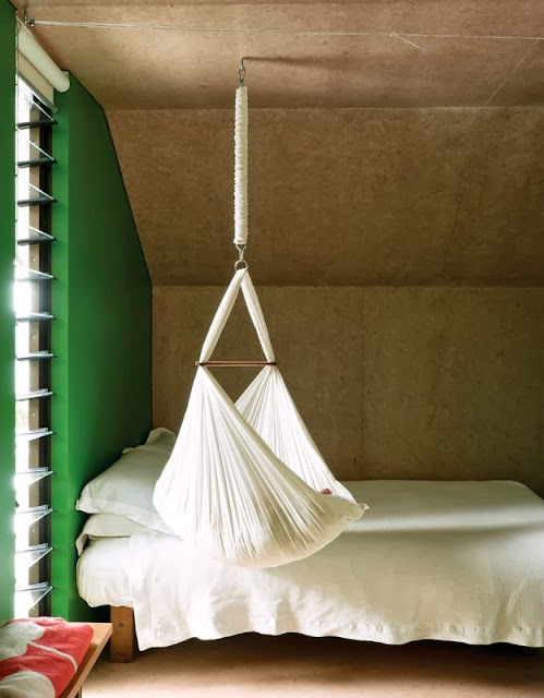 beautiful color combination inside the kids bedroom and a hammock for baby