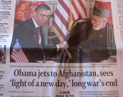 Obama jets to Afghanistan, sees 'light of new day,' long war's end