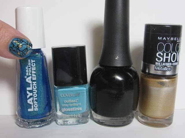 Bottle shot:  Layla Softtouch effect #10, Cover Girl Blue Hawaiian, Finger Paints Black Expressionism, and Maybelline Bold Gold.