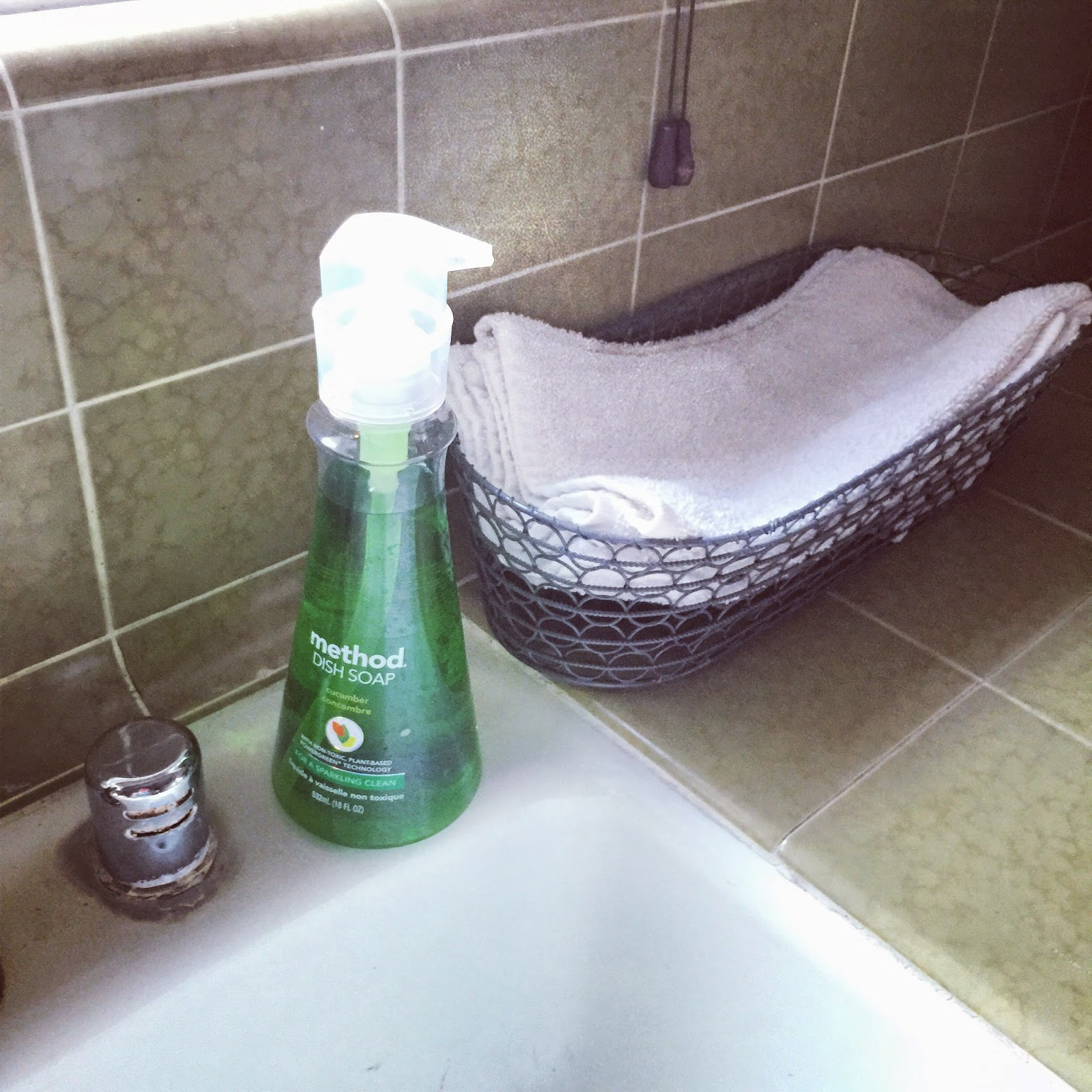 Inexpensive terry cloth towels in a bread basket near the kitchen sink :: OrganizingMadeFun.com