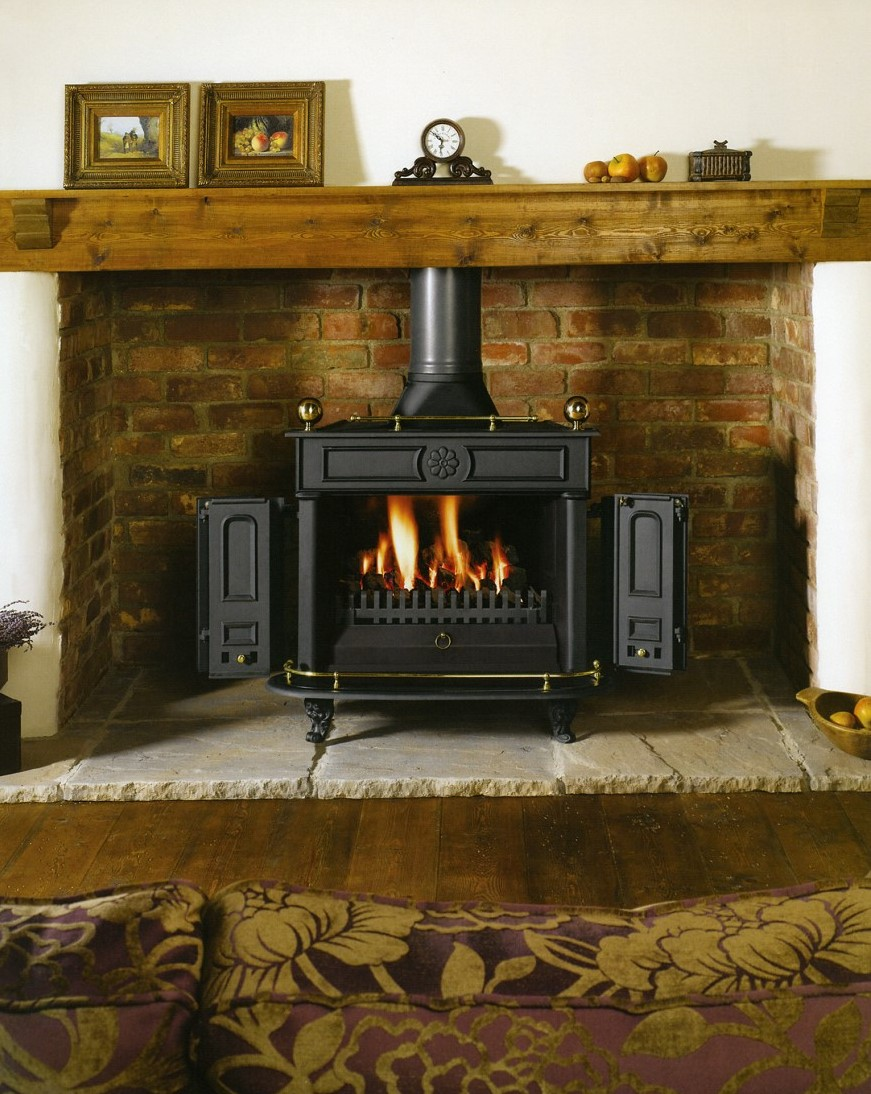 Adding some wood to your room all things nice for Wood fireplace surround designs