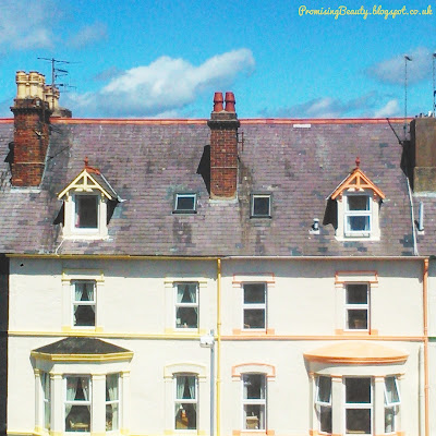 Pastel coloured guesthouses in Llandudno, North Wales. B&B in the summer by the seaside.