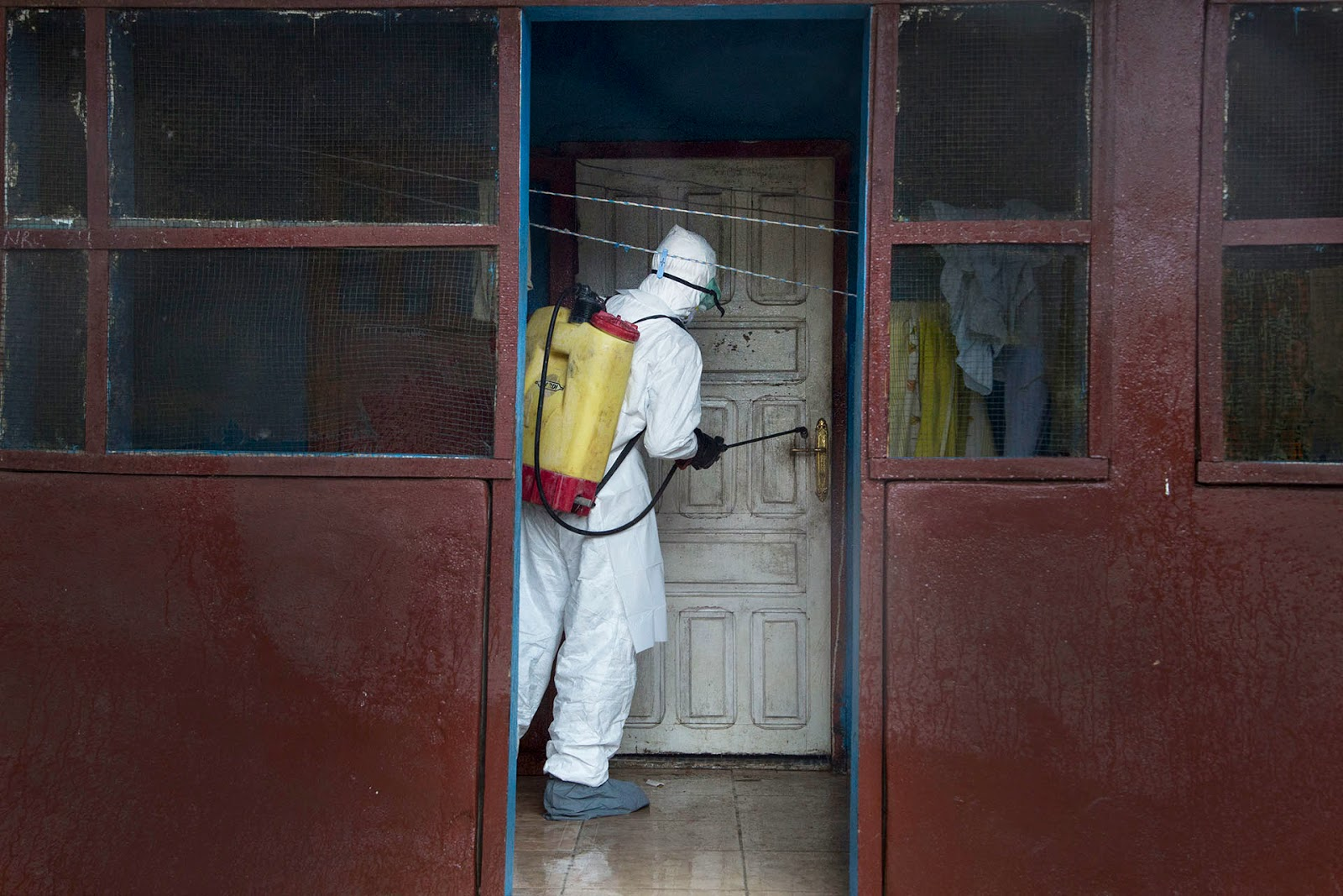 http://mashable.com/2014/10/24/ebola-liberia-hell-photographer/?utm_cid=mash-com-Tw-main-link