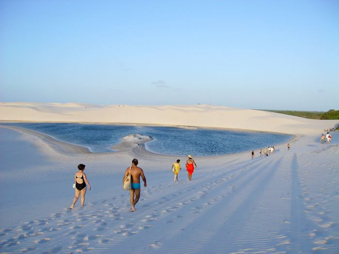 "The Lencois Maranhenses National Park Brazil (Parque Nacional dos Lençóis Maranhenses) is located in Maranhão state, in northeastern Brazil, just east of the Baía de São José, between 02º19'—02º45' S and 42º44'—43º29' W. It is an area of low, flat, occasionally flooded land, overlaid with large, discrete sand dunes. It encompasses roughly 1500 square kilometers, and despite abundant rain, supports almost no vegetation. The park was created on June 2, 1981. It was featured in the Brazilian film The House of Sand. Most recently, it was featured in the song ""Kadhal Anukkal"" from the Indian film, Enthiran."