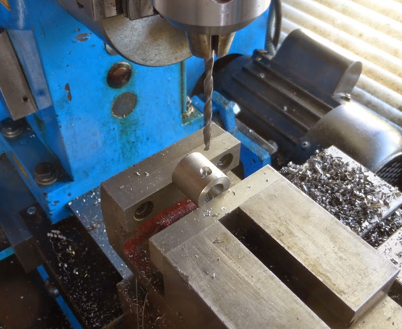 tap drilling the set screw hole