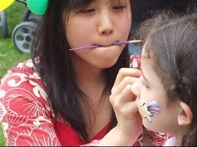 Face Painters Also Perform Pocket Magic