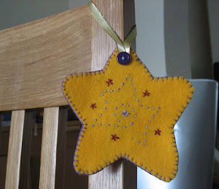 Photo of yellow felt star decoration