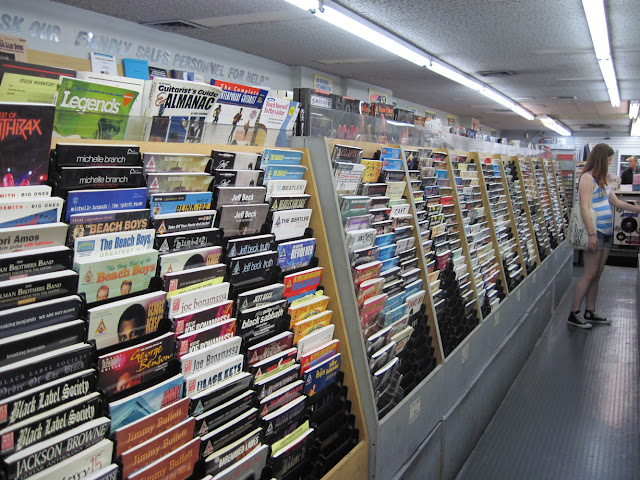 Colony Records is a great place for a musician to stop by and thumb through the sheet music and songbooks that adorn the walls