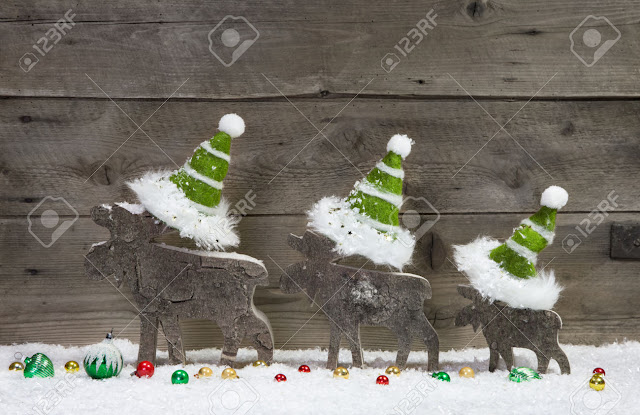 wooden madde deer wearing green colour cap christmas card greetings