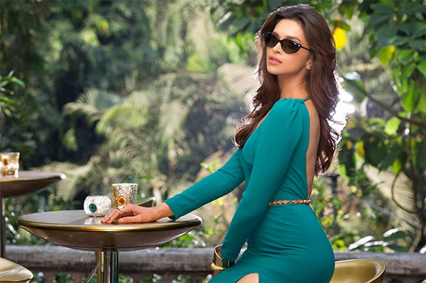 Deepika Padukone posing in green backless dress in Vogue Eyewear