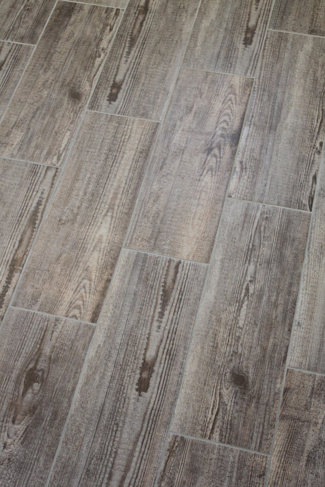 Bathroom update happenstance home Ceramic tile that looks like wood flooring