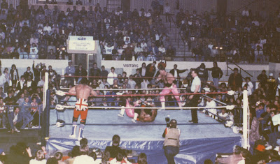 Davey Boy Smith suplexes Bret Hart in a WWF tag team title match in Newmarket, Ontario