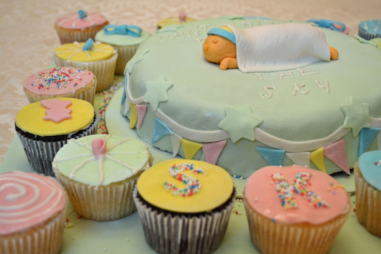 propped the baby on a light green fondant covered chocolate cake and ...