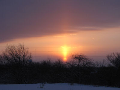 sun pillar with rising sun