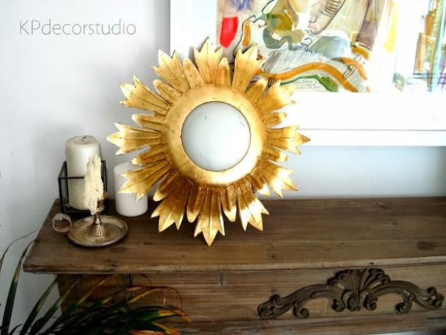Tienda online de decoración vintage. Apliques y lámparas doradas tipo sol y hojas metálicas