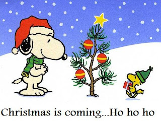 Christmas snoopy decorating Christmas tree with star and baubles by wearing Santa hat on head wallpaper