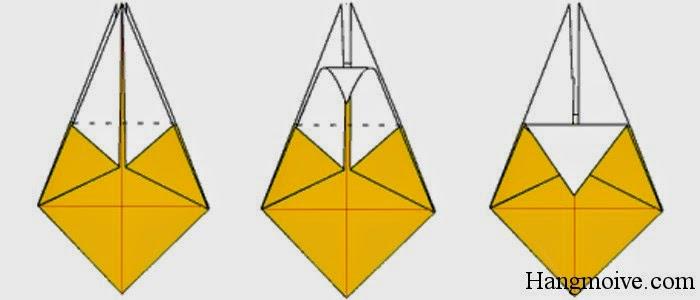 Bước 13: Gấp cạnh trên quả trám xuống phía dưới sao cho ta tạo thành một góc vuông.