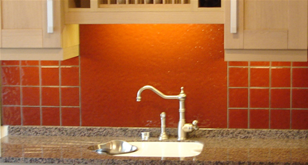White Kitchen Orange Splashback Concrete Worktops Combined With