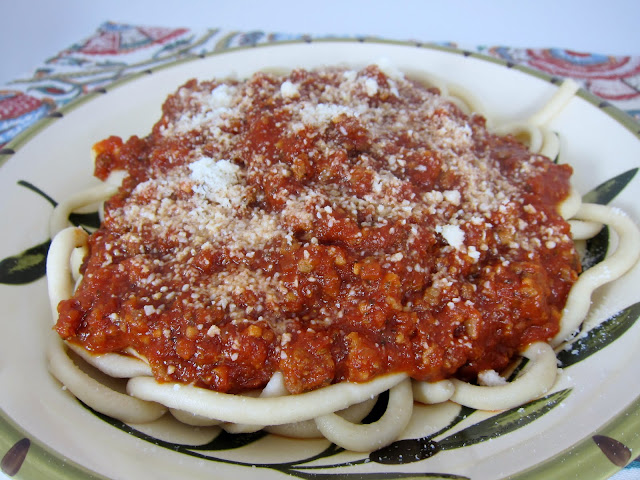THE BEST Slow Cooker Bolognese Sauce - Italian sausage, garlic crushed tomatoes, tomato paste, and spices cook all day in the crock-pot. Hands-down THE BEST spaghetti sauce EVER! Everyone raves about this sauce. We make this all the time. Freeze leftovers for a quick meal later!
