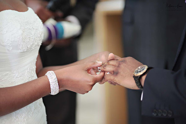 exchange of rings during ceremony at St John's Hyde Park wedding
