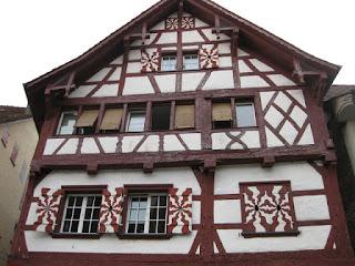Building with red beams, white walls, and shutters, Stein am Rhein, Switzerland.