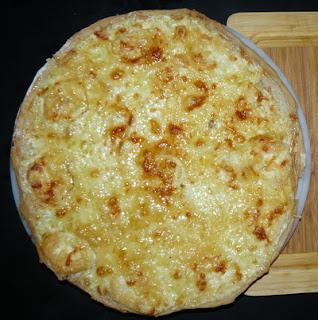 Pizza tomate roquette serrano