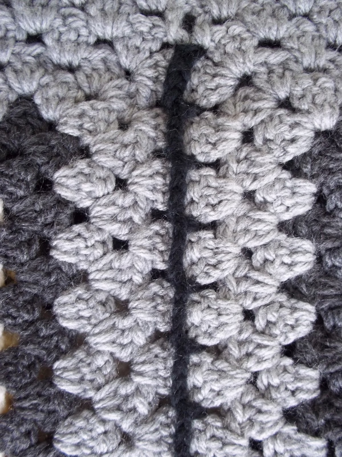 Squares crocheted together on wrong side with black yarn