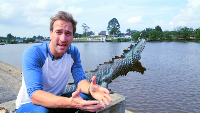 Screen grab shows Ben Fogle presenting the rich and romantic history of Sarawak's white rajah's (king) legacies as he sat at the Waterfront with the iconic Astana in the background.