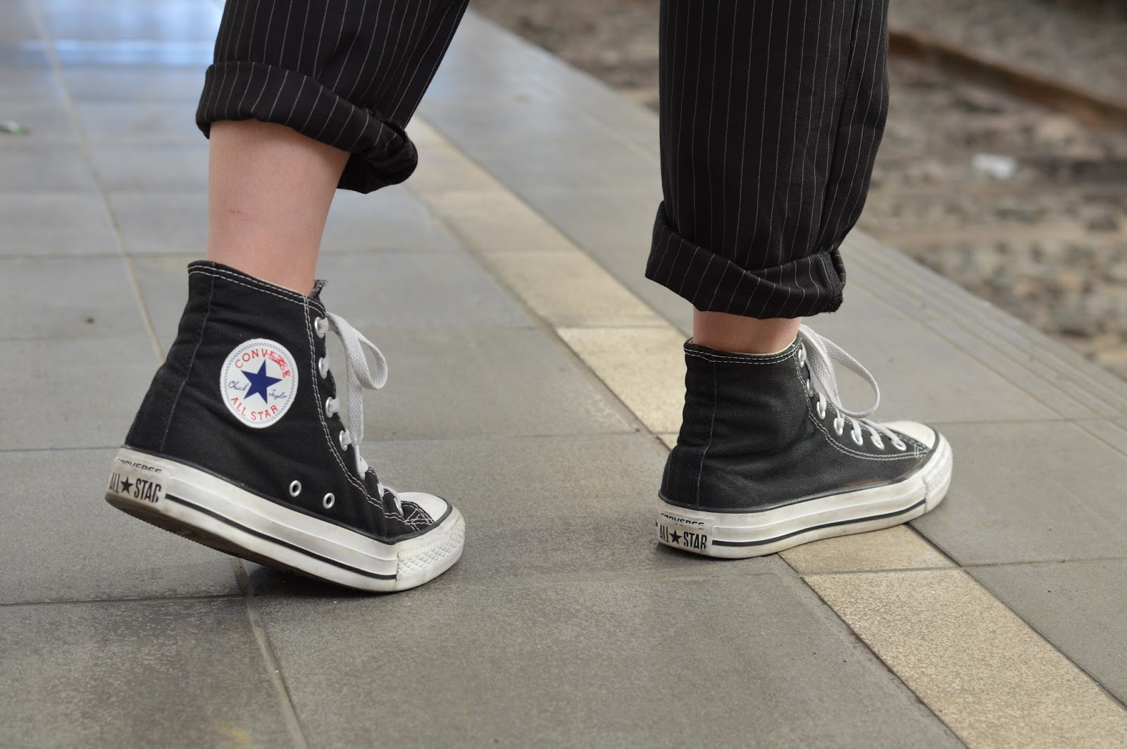 Converse and Missguided pinstripe dungarees at the train station