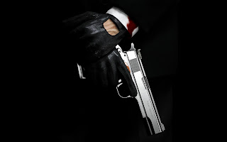 Hitman Holding Gun Leather Gloves and Suit HD Wallpaper