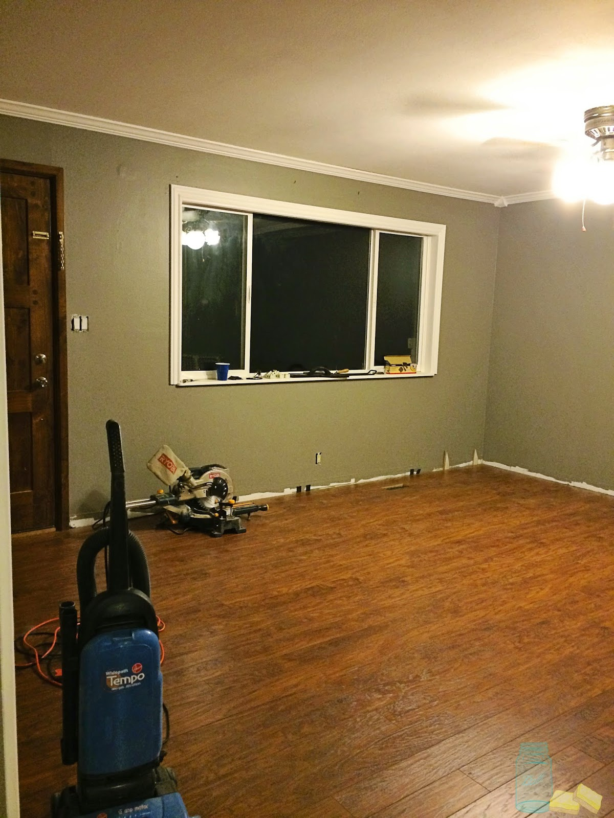 living room renovation during process laminte floors