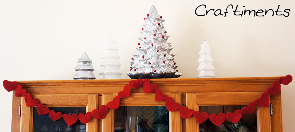 Craftiments:  Glittered tree-shaped candy jars, thrifted ceramic Christmas tree, heart garland