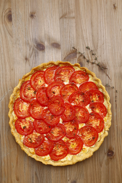A tomato tart on a wooden background