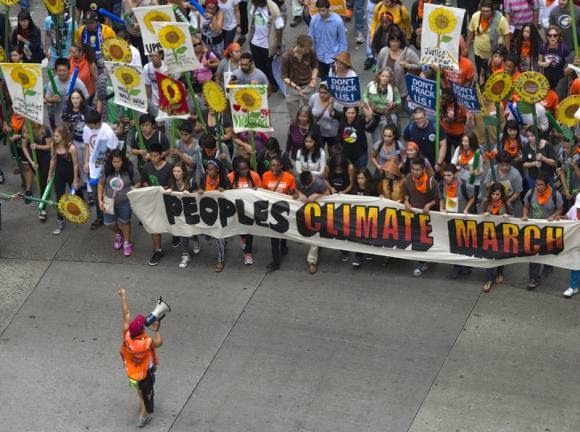 Activists hold a banner as they lead a march of tens of thousands down 6th Avenue during the People's Climate March through Midtown, New York September 21, 2014. (Credit: Reuters/Adrees Latif)  Click to enlarge.