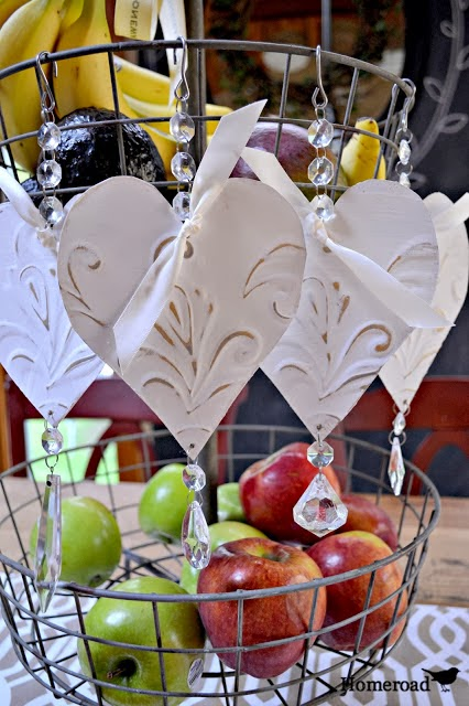 Make your own tin heart ornaments. Gorgeous and easy! via Homeroad, featured on http://www.ilovethatjunk.com