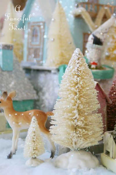 http://afancifultwist.typepad.com/a_fanciful_twist/2013/12/lets-make-vintagey-sparkly-bottle-brush-trees.html
