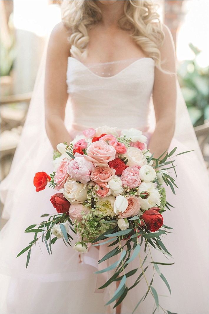 Romantic pink, white, and red bridal bouquet