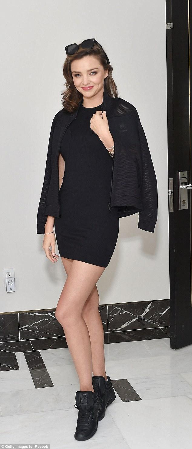 Miranda Kerr bares legs in little black dress at Reebok lunch in LA