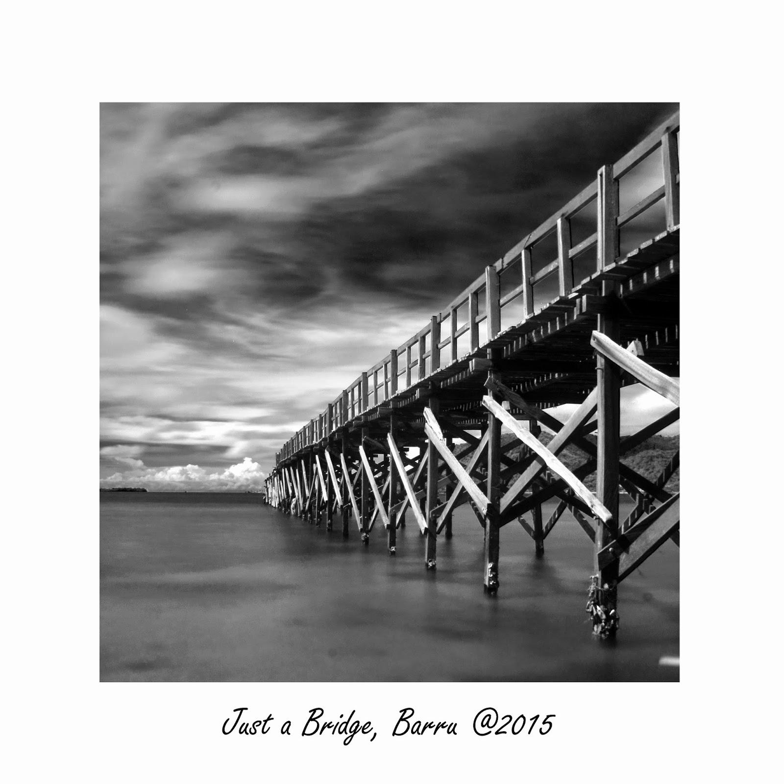 Long exposure of beach and bridge