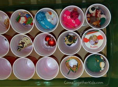 As I took the ornaments off the tree, I put them into the plastic cups,  filled up one layer, then added the second piece of cardboard and cups! - Come Together Kids: Christmas Ornament Storage Idea