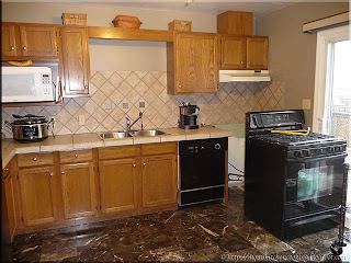 long counter with stove and dishwasher