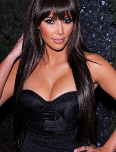 Kim Kardashian's boobs pops out