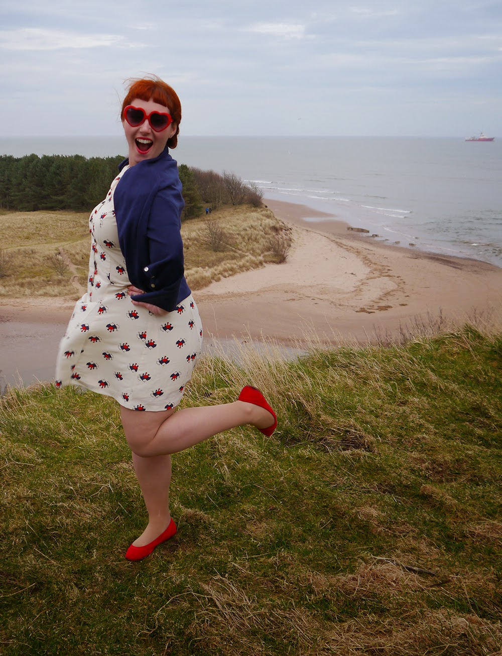 Scottish blogger, Ginger, red head, Vintage style dress, unmbrella print, Nishe dress, dreaming of spring, spring style, leopard print coat, cat eye glasses, Lunan Bay, Beach times